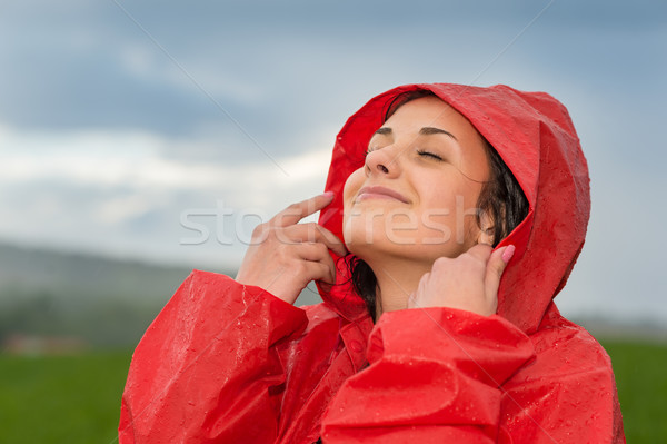 Young woman enjoying raindrops on her face Stock photo © CandyboxPhoto