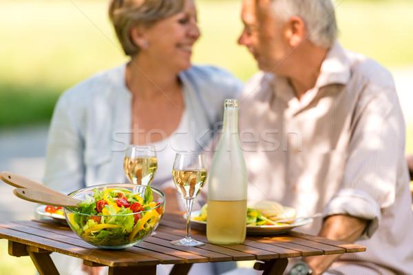 Couple de personnes âgées jouir de déjeuner extérieur seniors Photo stock © CandyboxPhoto