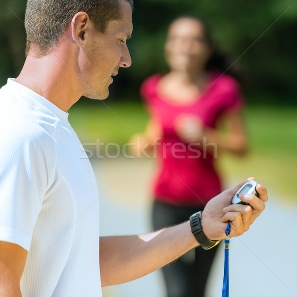Portrait of male coach timing runner  Stock photo © CandyboxPhoto