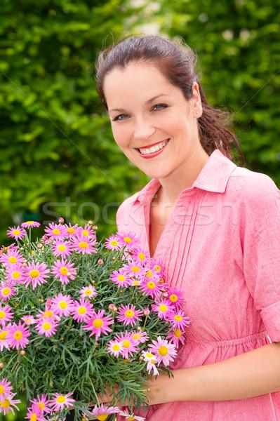 Stock fotó: Női · virágárus · tart · rózsaszín · virág · mosolyog