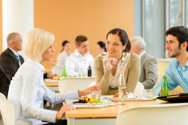 Cafeteria lunch young business people eat salad Stock photo © CandyboxPhoto