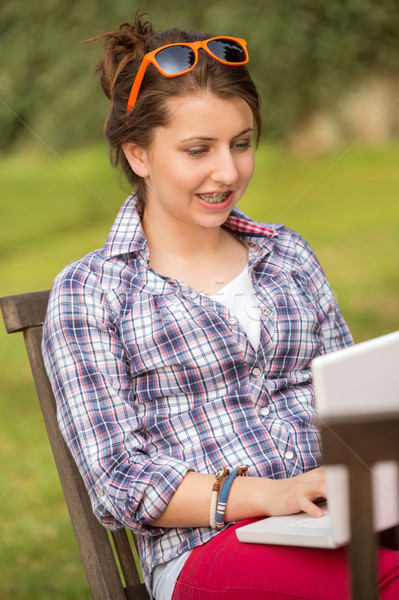 Girl using laptop sitting bench at park Stock photo © CandyboxPhoto