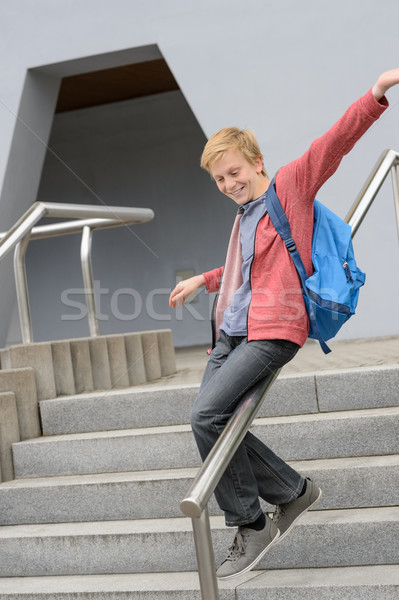 Student sliding down railing on stairway Stock photo © CandyboxPhoto