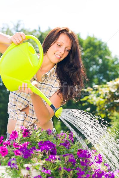 Сток-фото: садоводства · улыбающаяся · женщина · лейка · фиолетовый · цветок