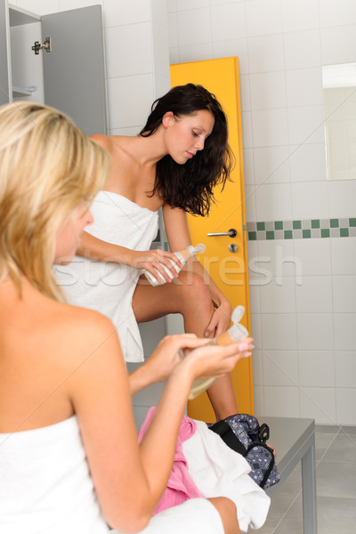 Locker room two sportive women applying lotion Stock photo © CandyboxPhoto