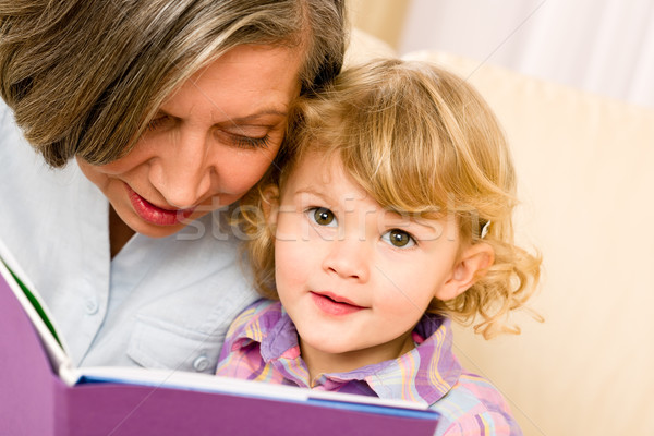 Grandmother and granddaughter read book together Stock photo © CandyboxPhoto