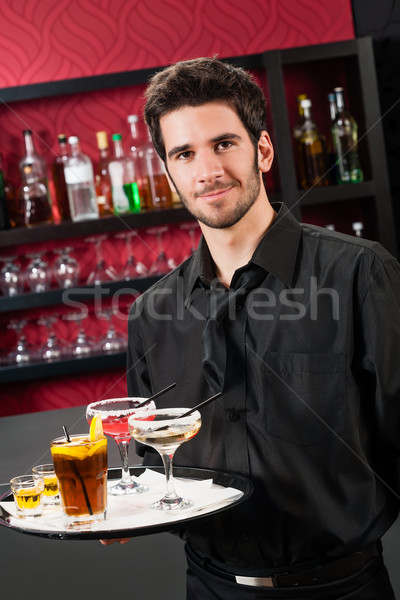 Stock photo: Professional barman cocktail bar hold serving tray