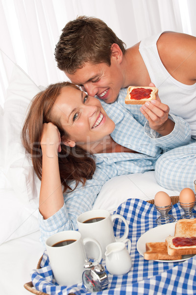 Young couple having home made breakfast in bed Stock photo © CandyboxPhoto