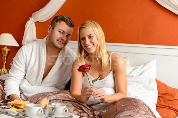 笑みを浮かべて カップル ベッド 朝食 祝う ストックフォト © CandyboxPhoto