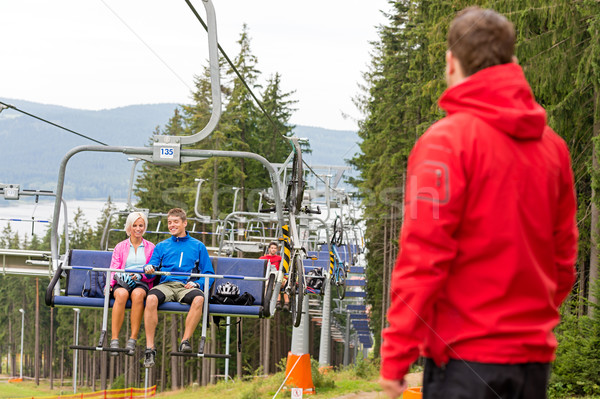 Young couple enjoying chair lift in wood Stock photo © CandyboxPhoto