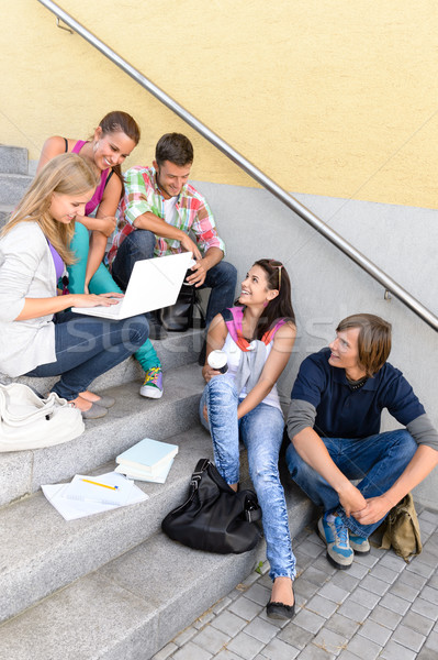 Students having fun with laptop school stairs Stock photo © CandyboxPhoto