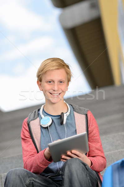 Happy boy using tablet sitting on steps Stock photo © CandyboxPhoto
