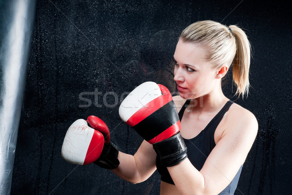 Boxing training woman with punching bag in gym Stock photo © CandyboxPhoto
