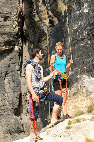 Rock climbing young man showing woman rope Stock photo © CandyboxPhoto