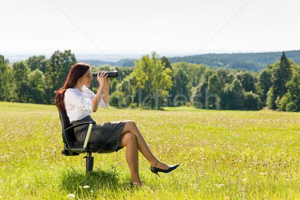 Businesswoman sit in sunny meadow seek binocular Stock photo © CandyboxPhoto