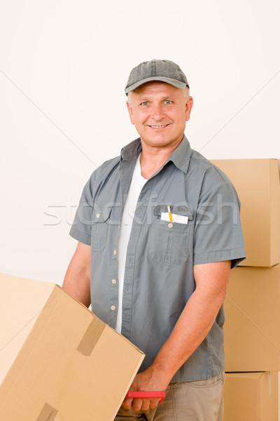Stock photo: Messenger mature male courier delivering parcels