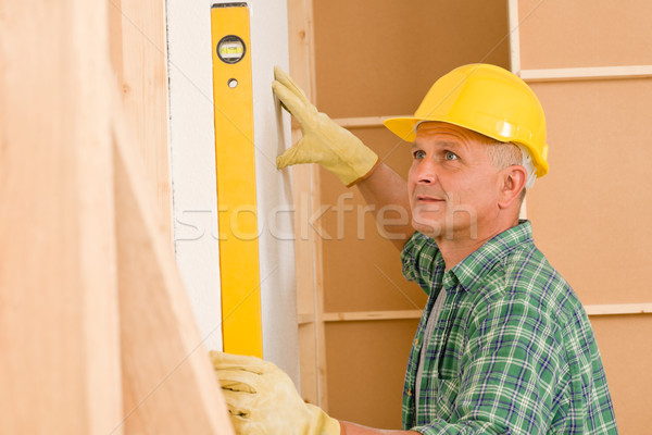Handyman mature professional with spirit level Stock photo © CandyboxPhoto