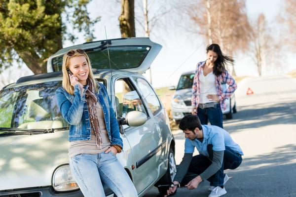 Stock photo: Broken wheel man helping two female friends