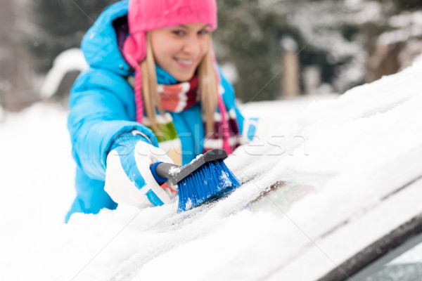 Woman wiping snow car window using brush Stock photo © CandyboxPhoto