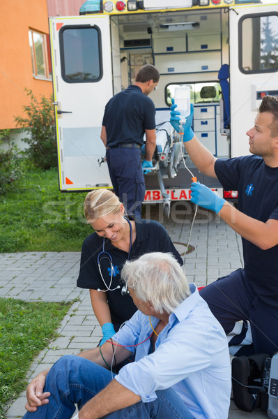 Emergency team treating injured patient on street Stock photo © CandyboxPhoto