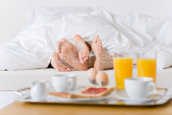 Luxury hotel honeymoon breakfast - couple in bed Stock photo © CandyboxPhoto