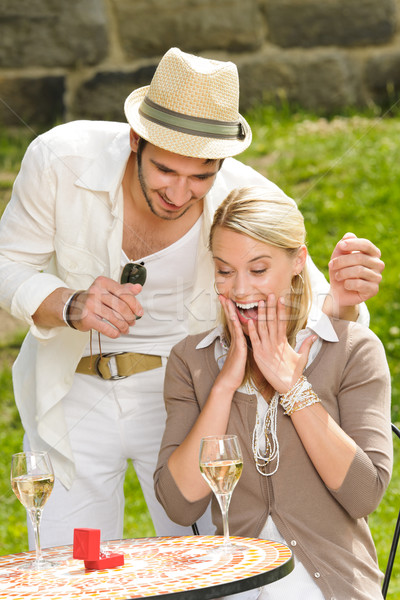 Surprised woman receiving wedding ring sunny terrace Stock photo © CandyboxPhoto