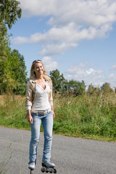 Pateni genç kadın güneşli asfalt yol Stok fotoğraf © CandyboxPhoto