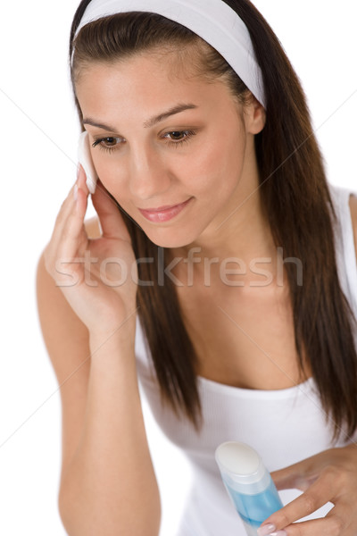 Beauty facial care - Teenager woman cleaning acne skin Stock photo © CandyboxPhoto