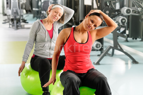 Senior woman with trainer stretching fitness ball Stock photo © CandyboxPhoto
