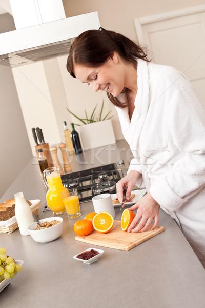 若い女性 バスローブ オレンジ キッチン 朝食 ストックフォト © CandyboxPhoto