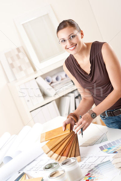 Young female designer with wooden color swatches Stock photo © CandyboxPhoto