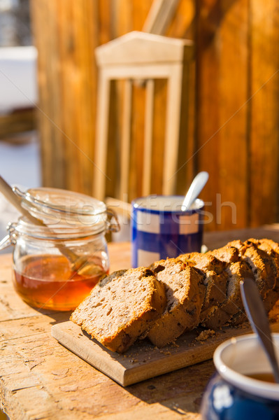 Tea and fruit bread outside winter cottage Stock photo © CandyboxPhoto