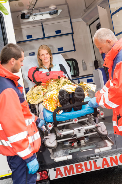 Patient secured in stretcher ambulance paramedics Stock photo © CandyboxPhoto