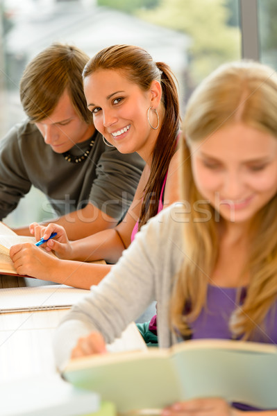 Stock photo: Teens study in high-school library reading student