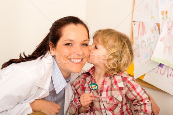 Pediatrician woman get kiss from child girl Stock photo © CandyboxPhoto