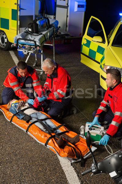 Paramedics assisting motorbike driver on stretcher Stock photo © CandyboxPhoto