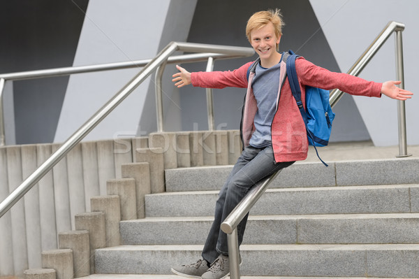 Playful student sliding down handrail on stairway Stock photo © CandyboxPhoto