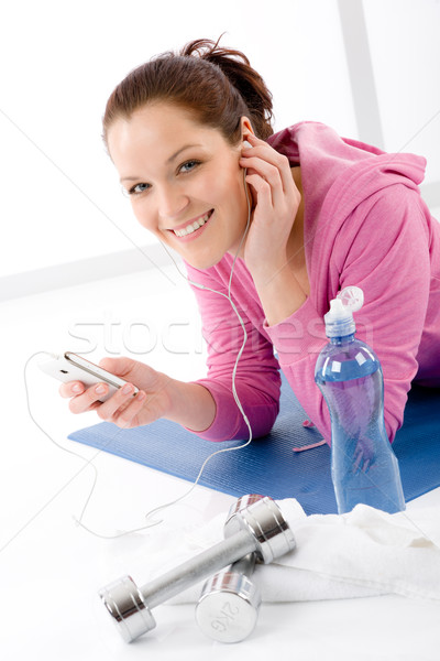 Stock photo: Fitness woman listen music mp3 relax gym