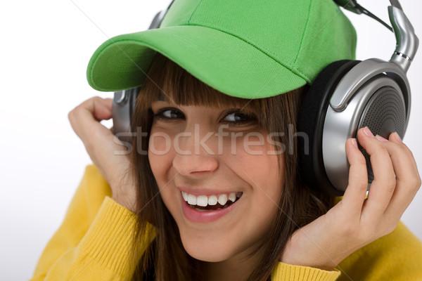 Boldog női tinédzser élvezi zene fehér Stock fotó © CandyboxPhoto
