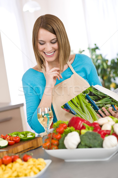 Cooking - Smiling woman holding cookbook, with vegetable and pas Stock photo © CandyboxPhoto