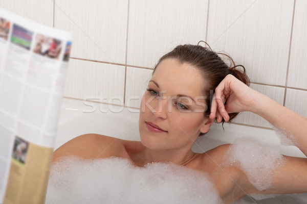 Body care series - Young woman with magazine in the bathtub Stock photo © CandyboxPhoto