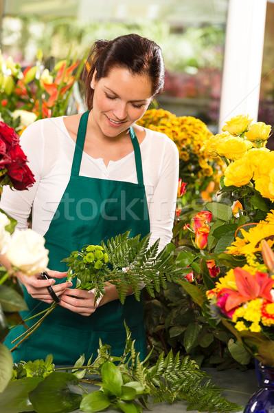 Young florist preparing flowers bouquet shop store Stock photo © CandyboxPhoto