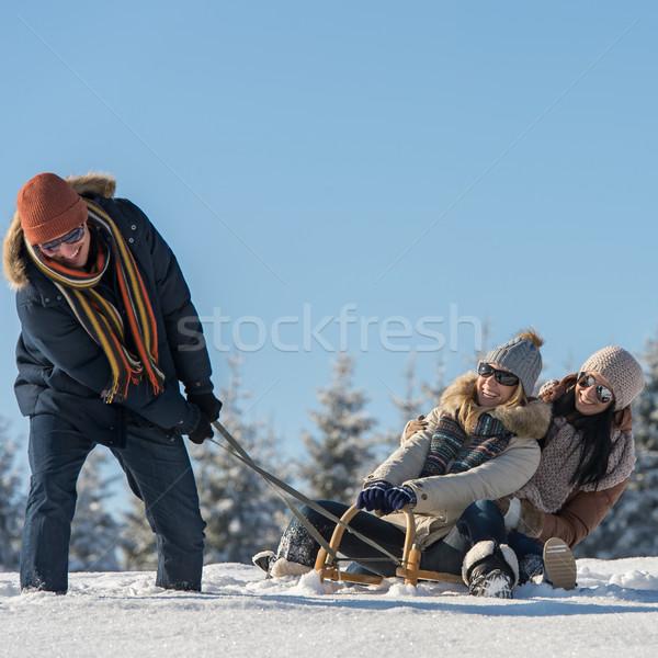Friends having fun on sledge sunny winter Stock photo © CandyboxPhoto