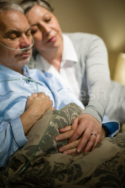 Loving elderly couple sleeping in bed Stock photo © CandyboxPhoto