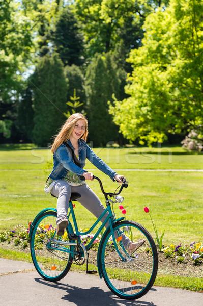 Girl enjoying summer break riding bicycle Stock photo © CandyboxPhoto