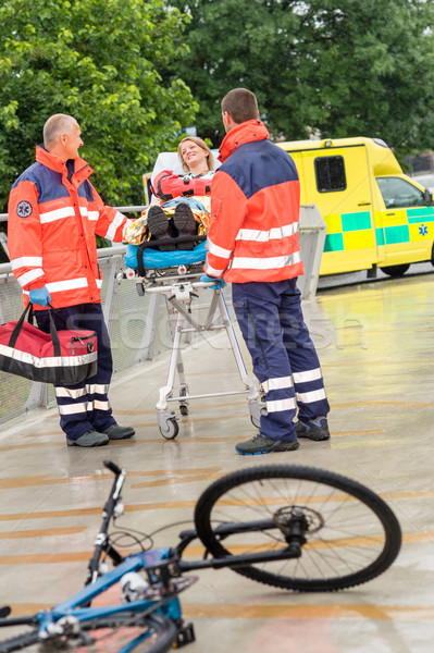 Paramedics with woman on stretcher ambulance aid Stock photo © CandyboxPhoto