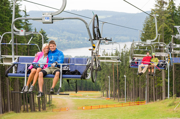 Smiling couples using chair lift scenic landscape Stock photo © CandyboxPhoto