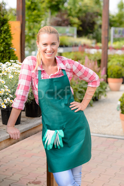Garden center smiling woman worker looking camera Stock photo © CandyboxPhoto