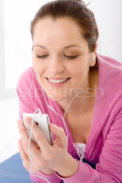 Stock photo: Fitness woman listen music mp3 relax