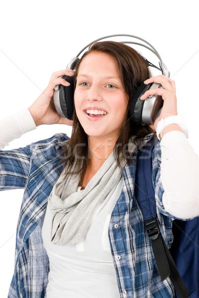 Mosolyog női tinédzser élvezi zene fejhallgató Stock fotó © CandyboxPhoto